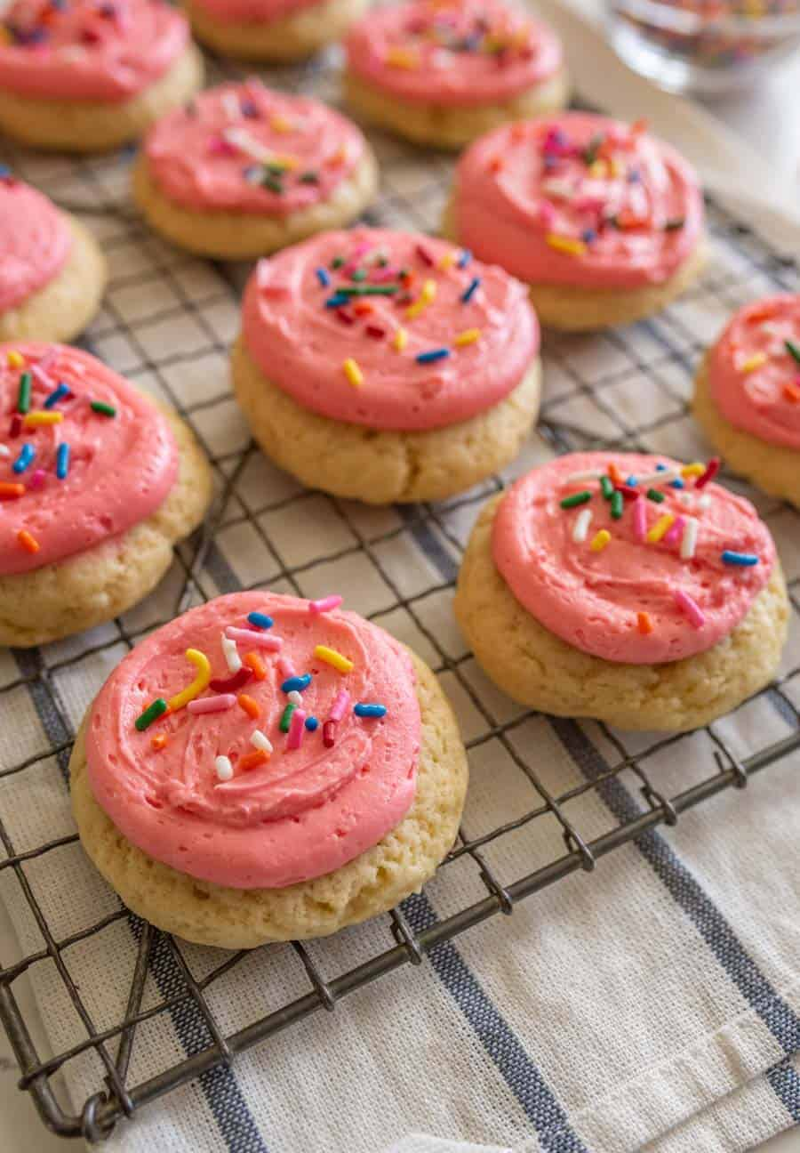 pink frosted cookie on cooling rack