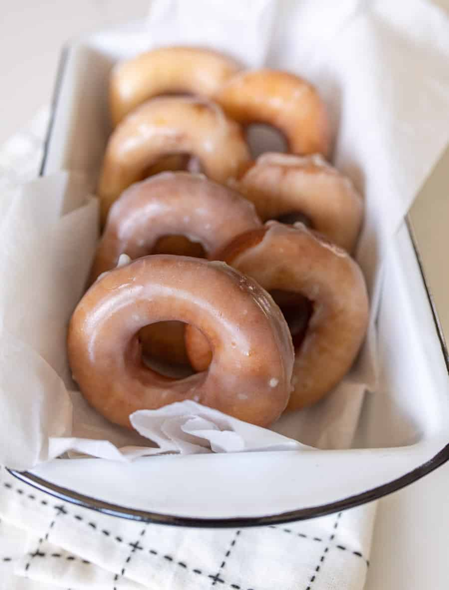 glazed donuts resting a pan to serve