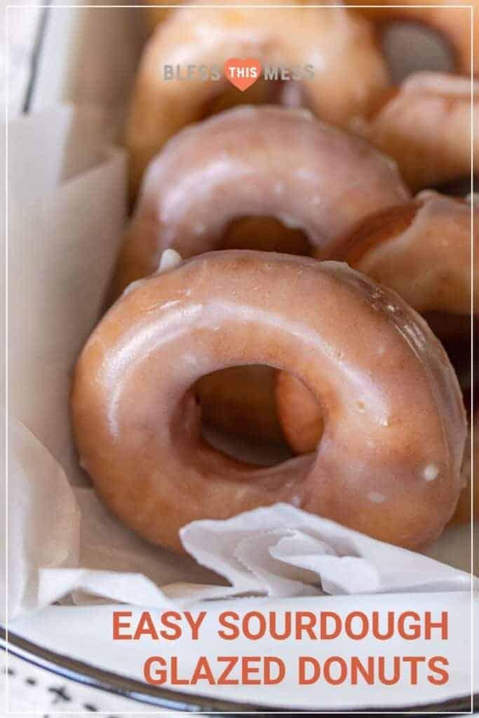 closeup of sourdough glazed donuts on parchment