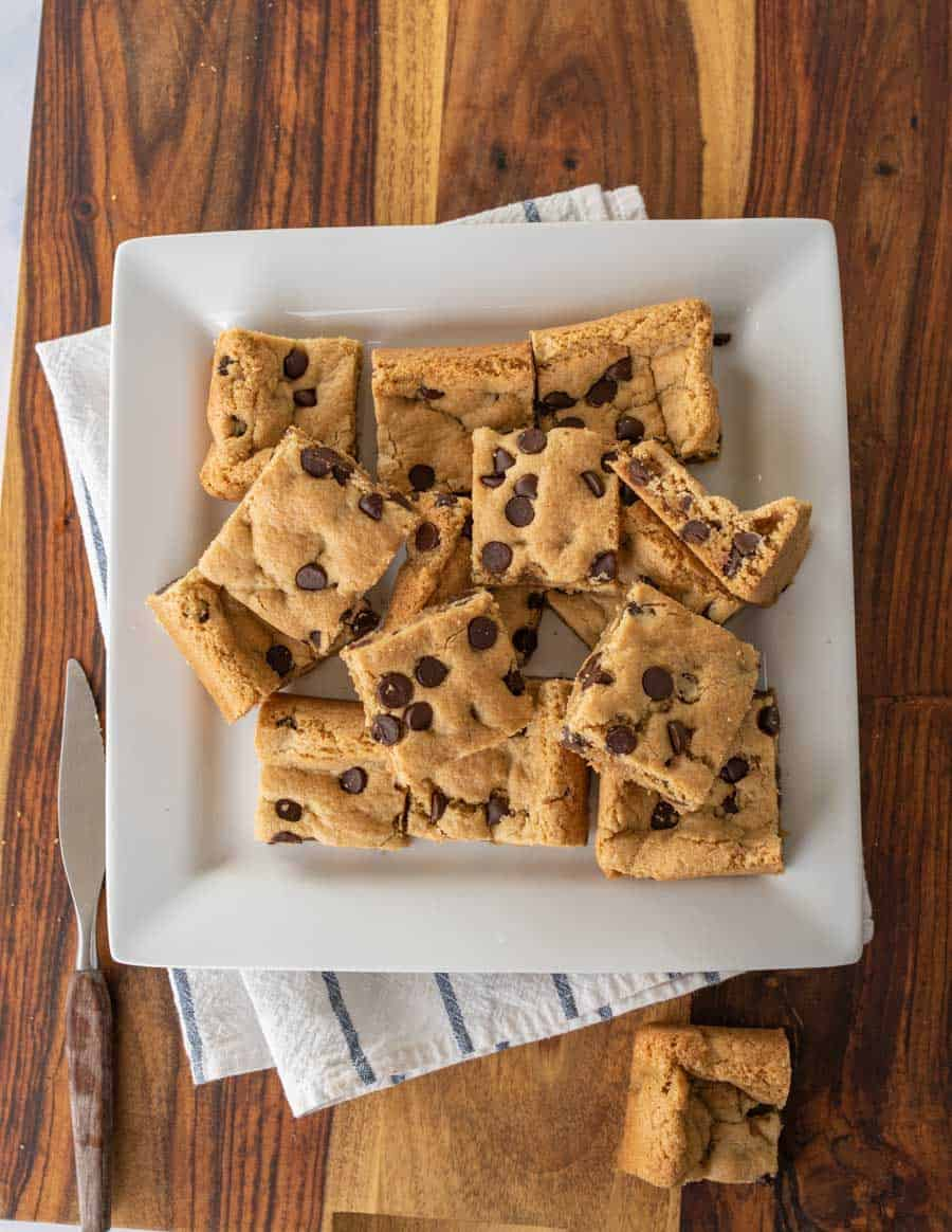 baked and sliced almond flour chocolate chip cookies bars on white serving platter