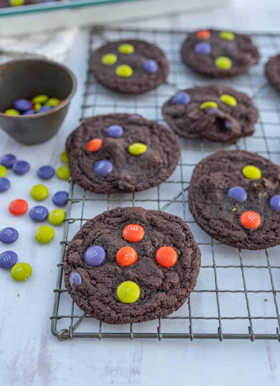 dark chocolate Halloween M&M cookies on cooling rack