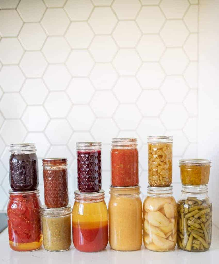 14 jars of various home canned products displayed together