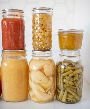 6 jars of various home canned products displayed together