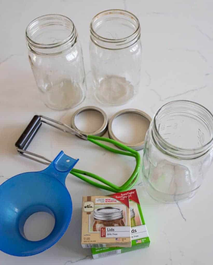 jars, lids, and funnel for canning supplies