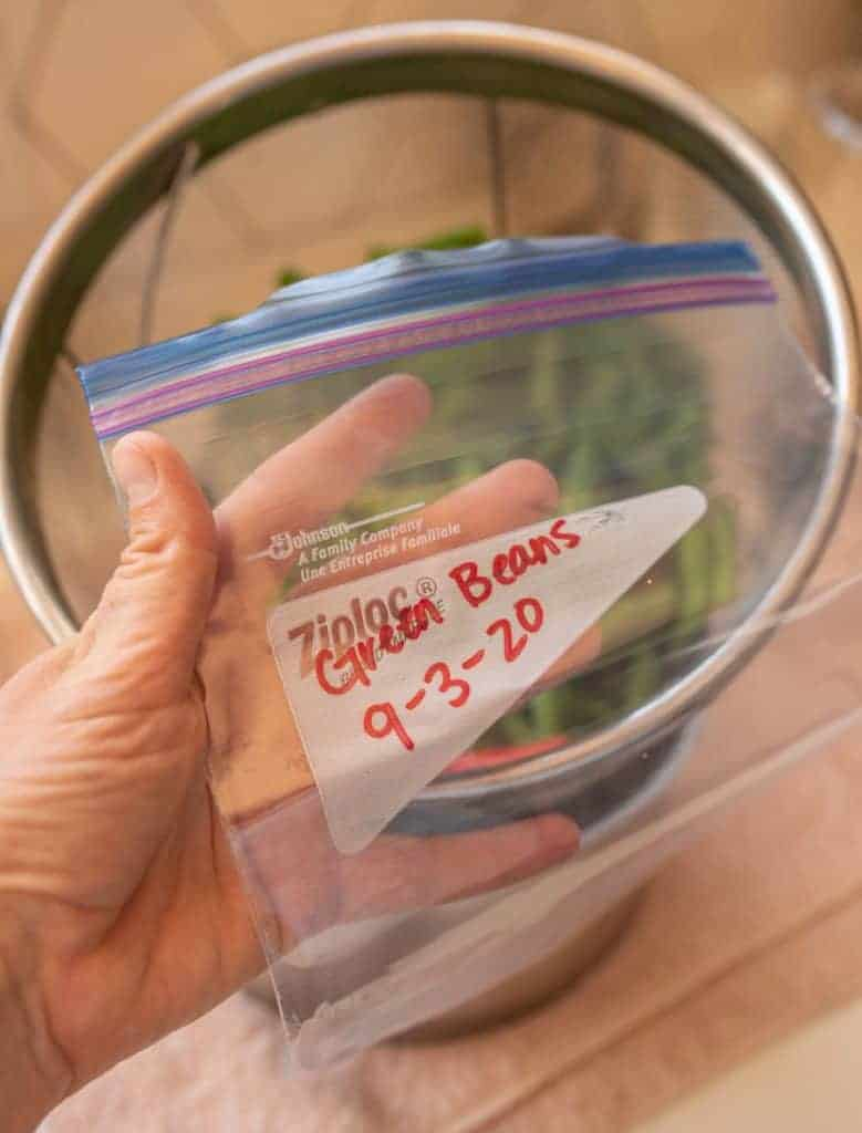 freezer bag labeled with green beans and date