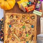 uncut cookie bars on a cutting board