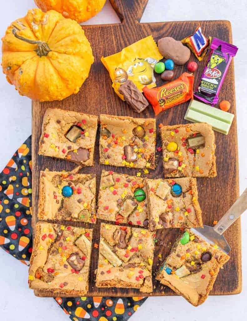 haloween candy and cookie bars on a board
