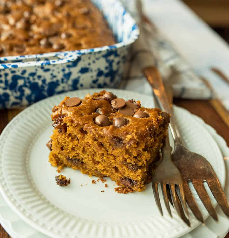 pumpkin cake on white plate with fork