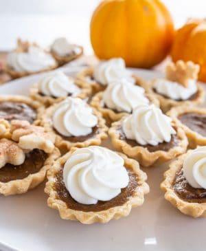 mini pumpkin pie with whipped cream swirl on top