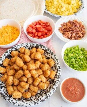 breakfast burrito ingredients in bowls