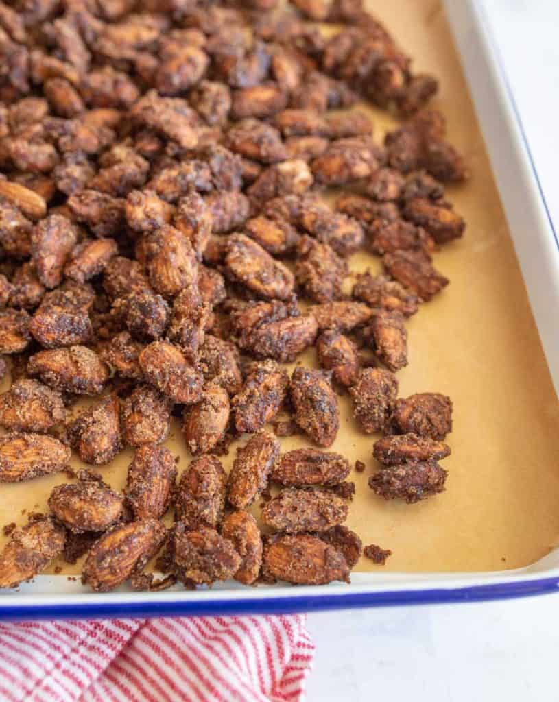 candied almonds on a baking sheet
