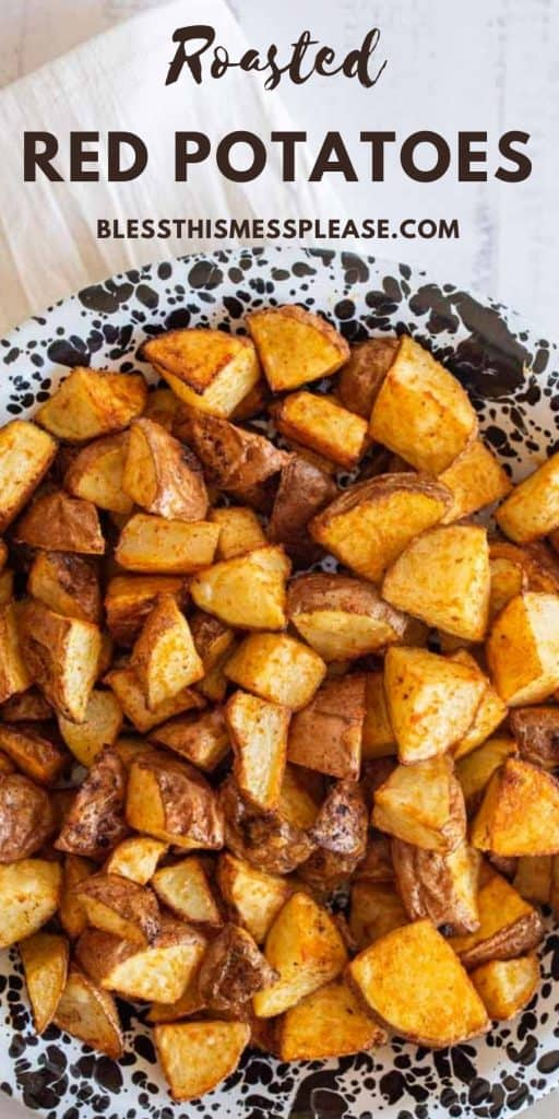 """photo of a bowl of roasted red potatoes with the words """"roasted red potatoes"""" written on the top"""