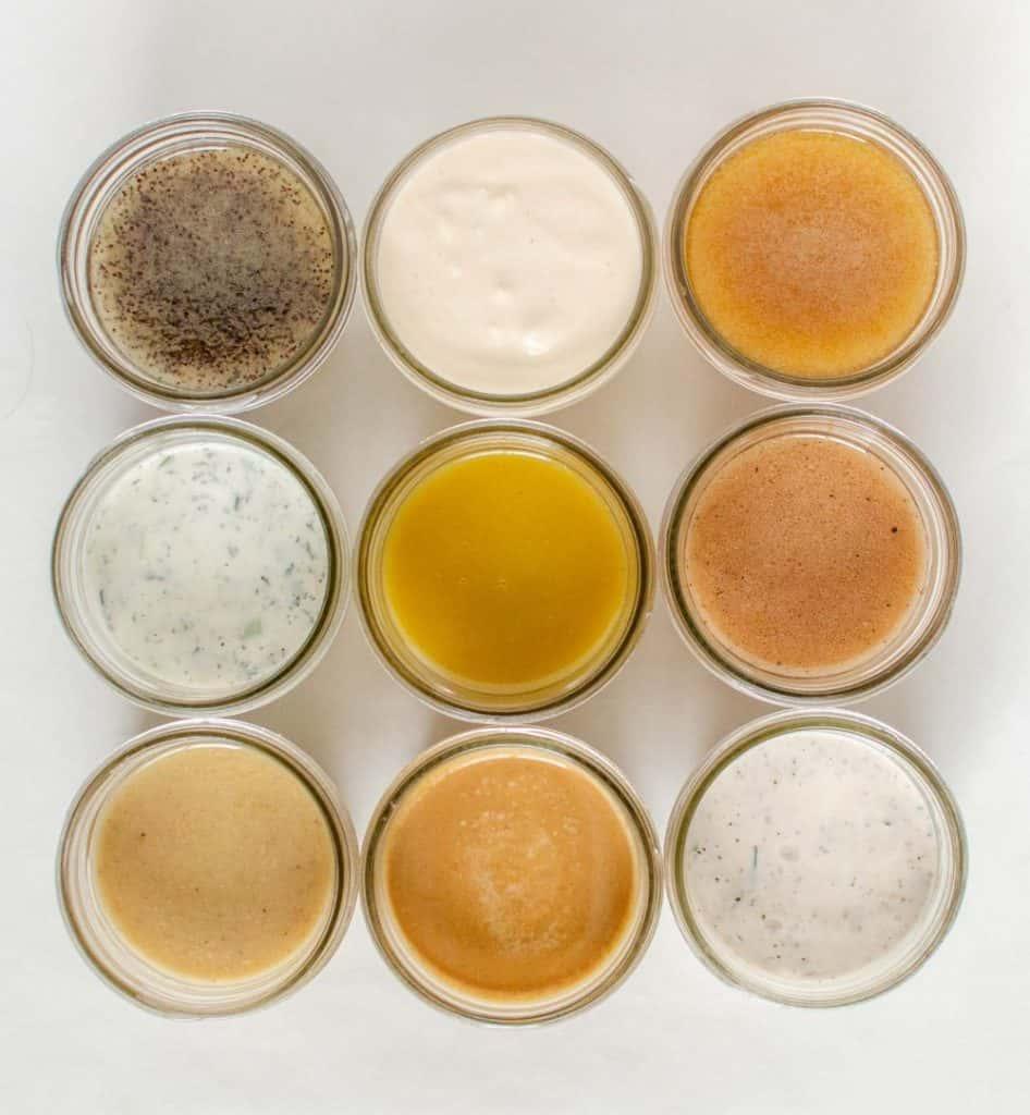 Top view of nine jars of different salad dressings