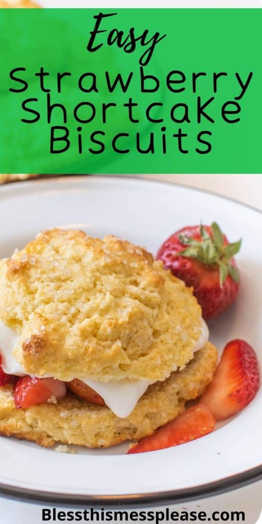 """Photo of a bowl with a shortcake biscuit with sliced strawberries and whipped cream with the words """"easy strawberry shortcake biscuits"""" written at the top"""