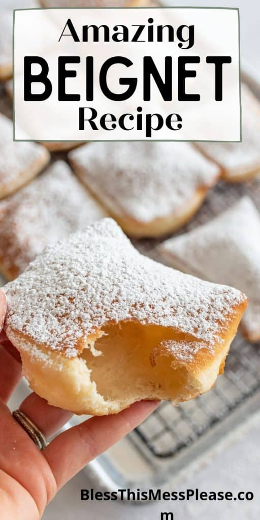 """picture of a hand holding a beignet with a bite taken out of it and the words """"amazing beignet recipe"""" written at the top"""