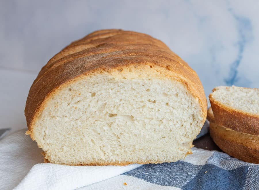 close up of a loaf of Italian bread that has been cut into