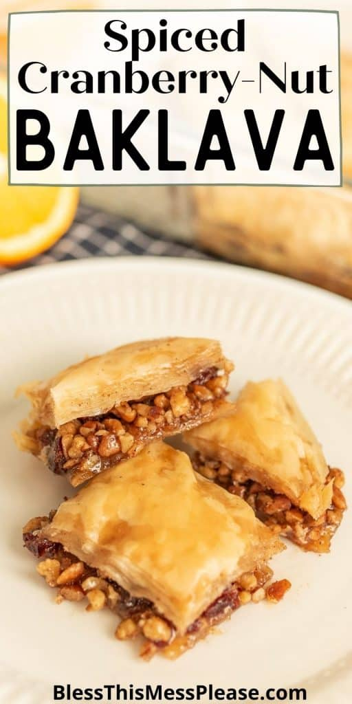"""squares of baklava on a plate with the words """"spiced cranberry-nut baklava"""" written at the top"""