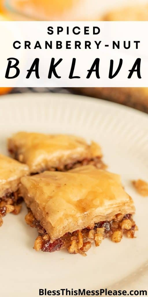 """close up picture of a square of baklava on a plate with the words """"spiced cranberry-nut baklava"""" written at the top"""