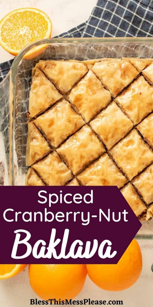 """baking pan of baklava next to oranges with the words """"spiced cranberry-nut baklava"""" written at the bottom"""