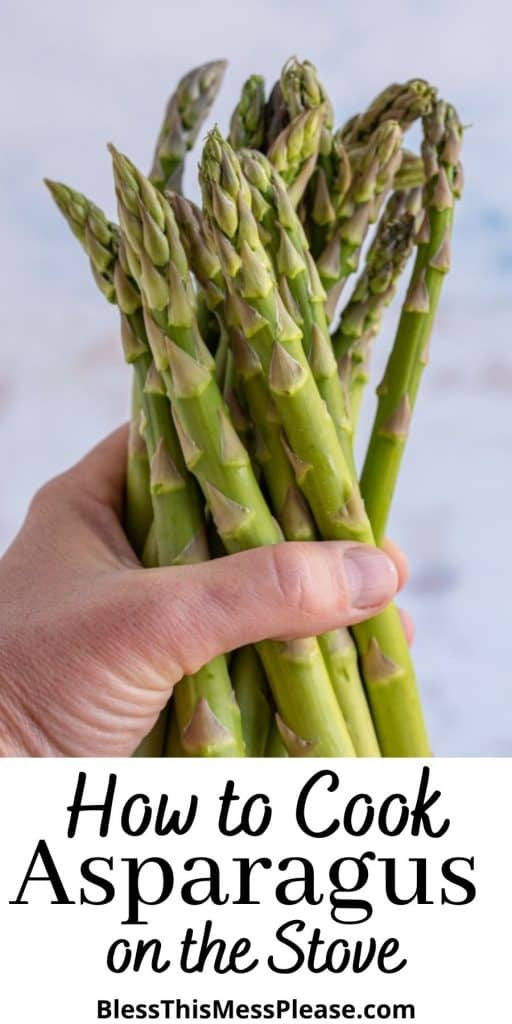 """picture of a hand holding asparagus with the words """"how to cook asparagus on the stove"""" written at the bottom"""