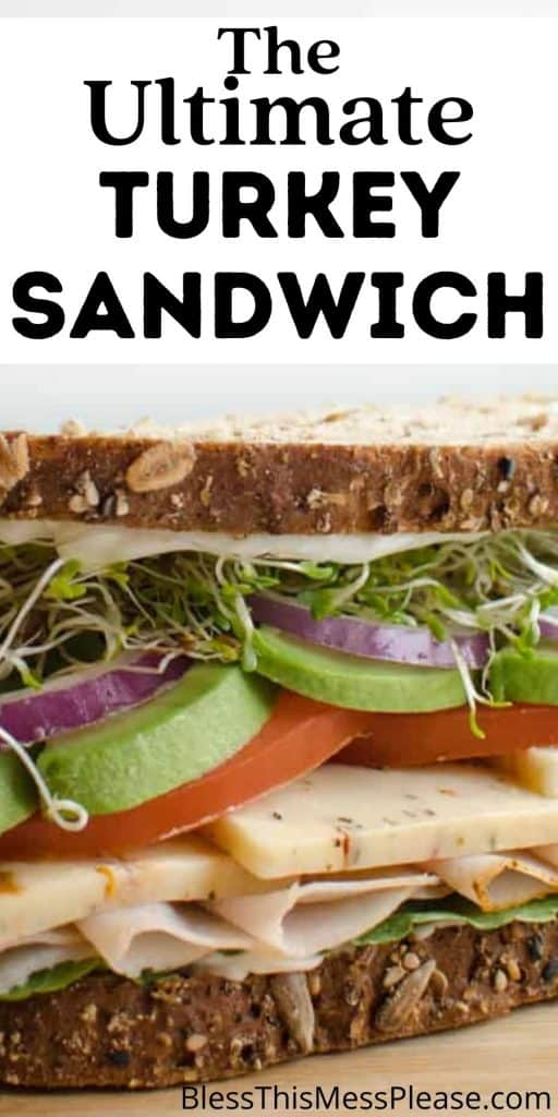 """Close up picture of a turkey sandwich with the words """"The ultimate turkey sandwich"""" written at the top"""