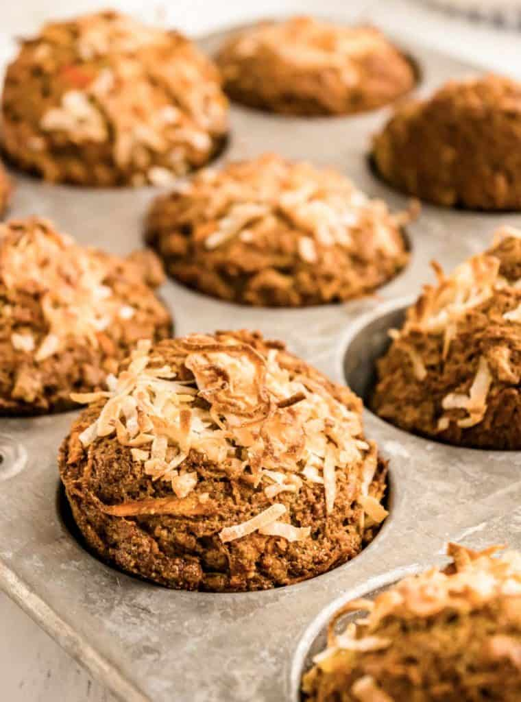 close up picture of morning glory muffins in a tin