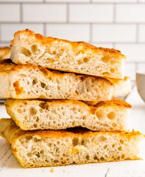 slices of focaccia bread stacked on top of each other