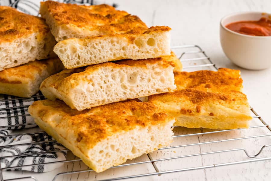 close up of slices of focaccia bread stacked on each other