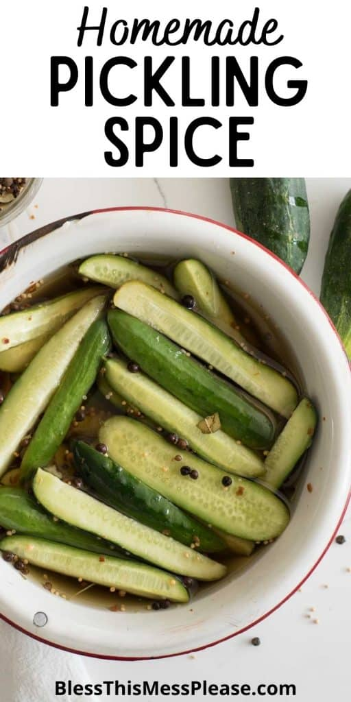 """top view of a bowl of cucumbers in vinegar with pickling spice and the words """"homemade pickling spice"""" written at the top"""