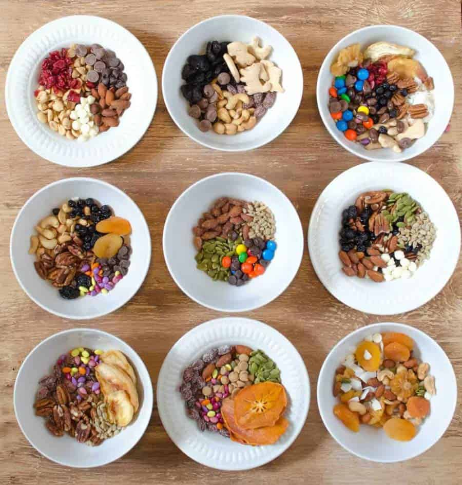 top view of ingredients for trail mix in different bowls