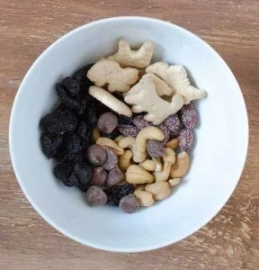 top view of ingredients for trail mix in a bowl