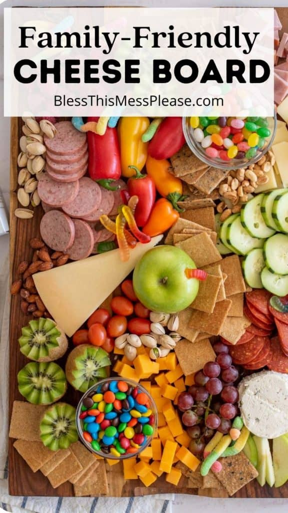 """top view of a cheese board with the words """"family-friendly cheese board"""" written at the top"""