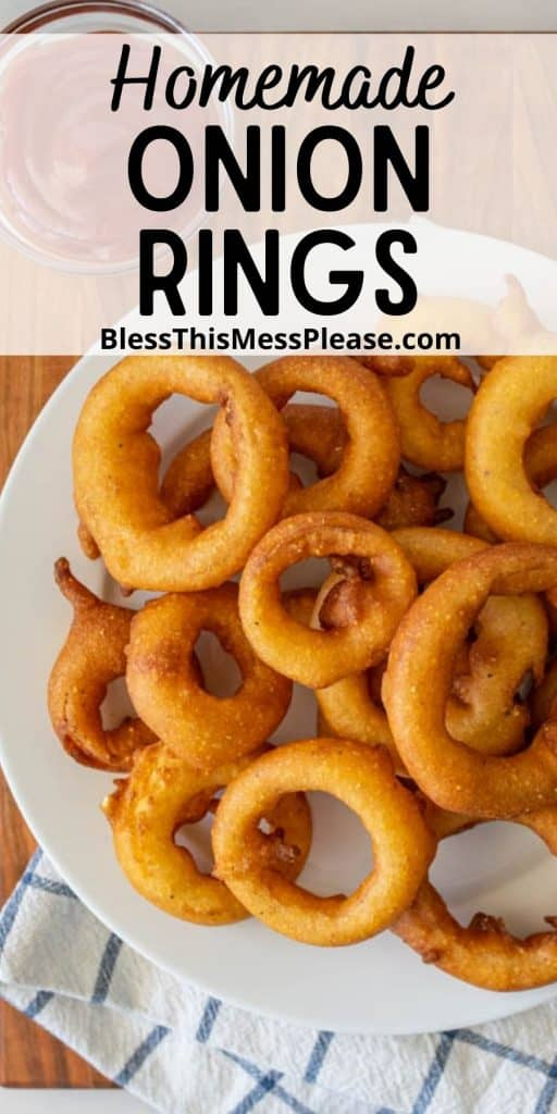 """top view of a plate of onion rings with the words """"homemade onion rings"""" written at the top"""