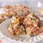 close up picture of fruity pebble treats on a plate