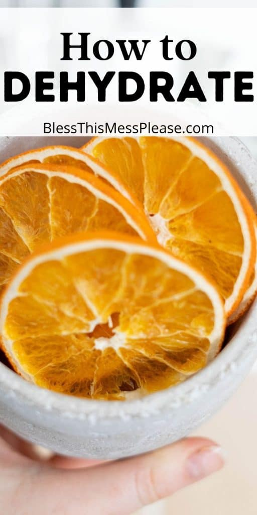 """bowl of dehydrated orange slices with the words """"how to dehydrate"""" written at the top"""