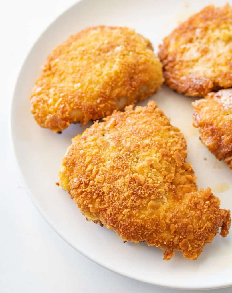 close up parmesan crusted chicken on a plate