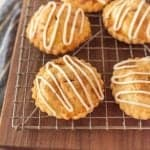 close up picture of apple hand pies on a cooling rack