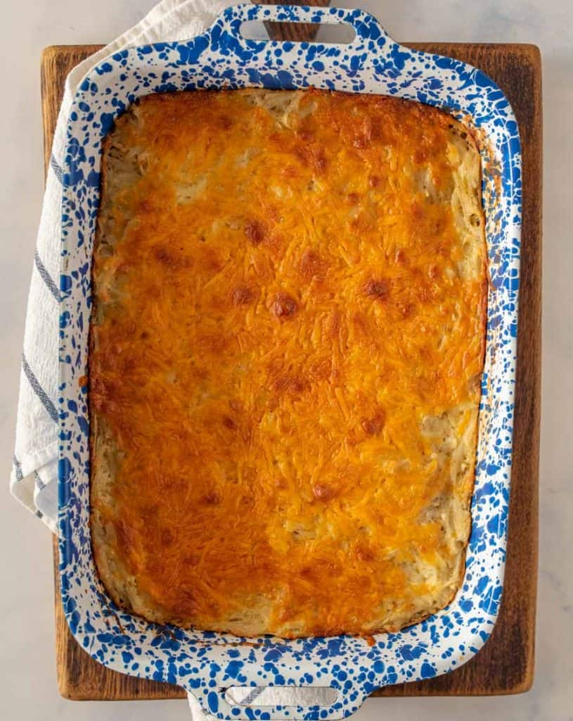 top view of cheesy potato casserole in a baking dish