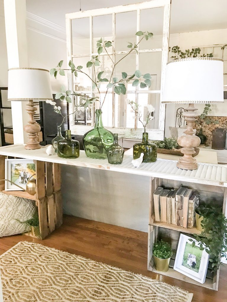 entryway, console table, green bottles