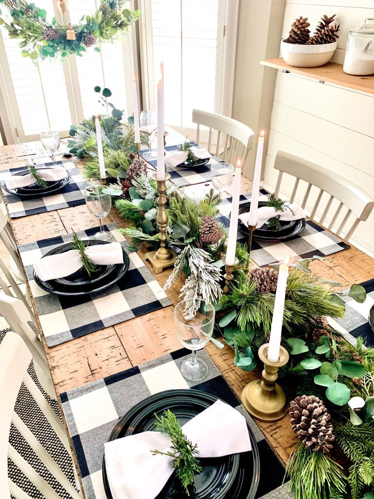Christmas table setting with placemats and garland.