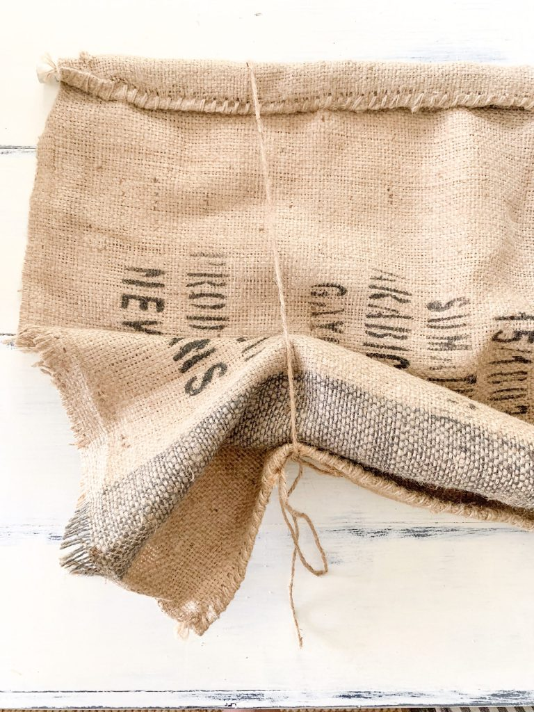 burlap sack with twine tie.