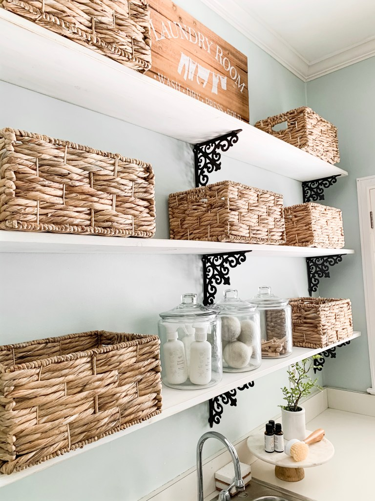 laundry room shelves with baskets and jars for organization
