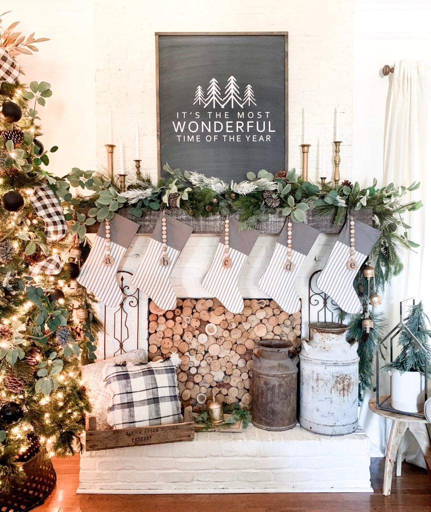 Christmas sign and candlesticks on mantel.