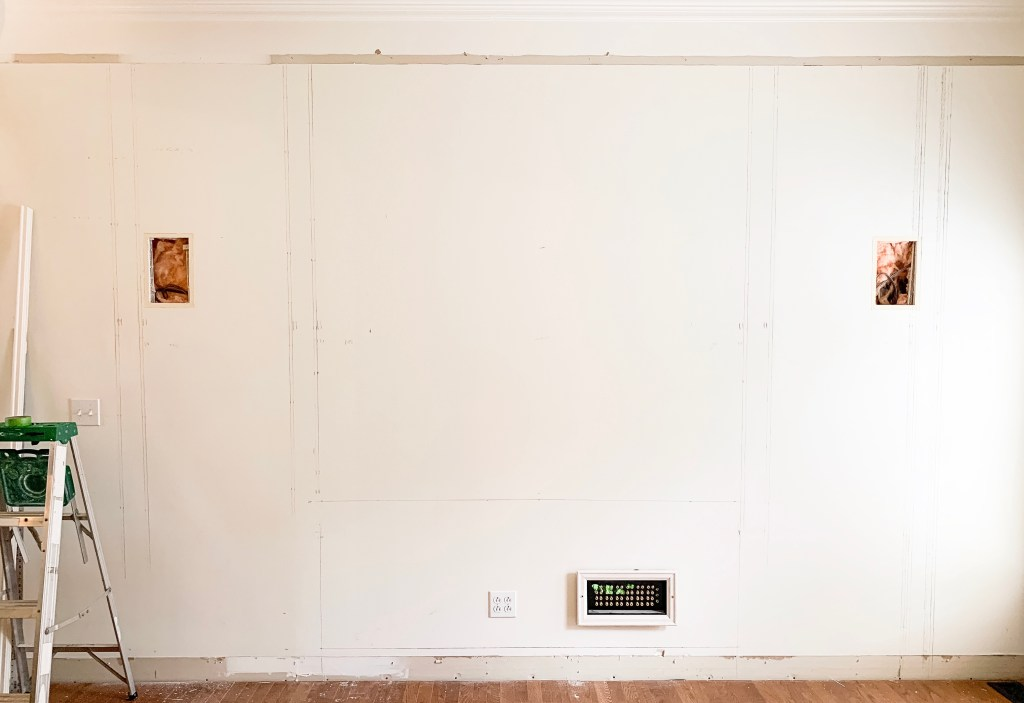 wall with measurements for media cabinet drawn on the wall