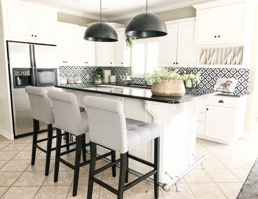 kitchen refresh after photo of white kitchen and black and white backsplash.