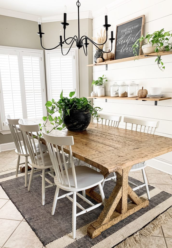 farmhouse table with black mud paint pot centerpiece