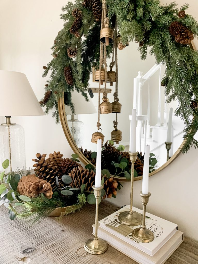 greenery and gold accessories on entryway table