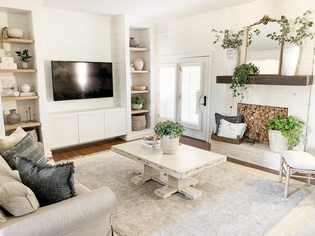 view of living room with media cabinet on the wall