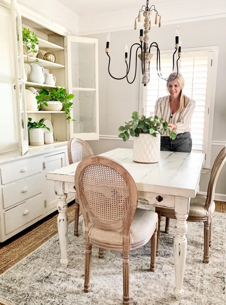 Carissa arranging a table centerpiece