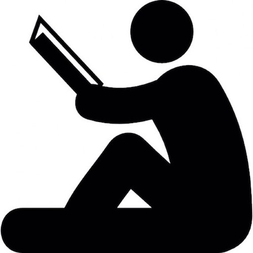 side-view-of-sitting-man-reading_318-29449